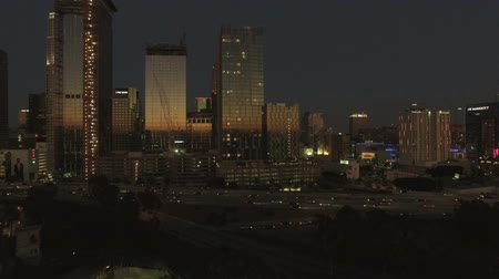 talapzat : Stunning aerial rise of Los Angeles skyline at last light Stock mozgókép