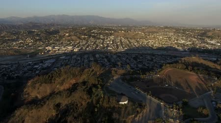 Aerial clip above baseball fields and Cypress Park neighborhood of Los Angeles