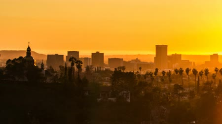 Los Angeles buildings at sunset with lens flare - time lapse Stock mozgókép