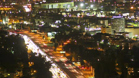 Time lapse tilt pan shot above Hollywood and the 101 freeway at night