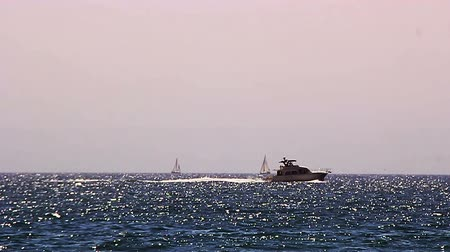 Telephoto shot of boats in the Pacific Ocean
