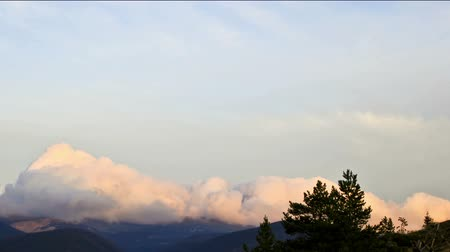 Awesome timelapse clouds rolling over ridge of mountain