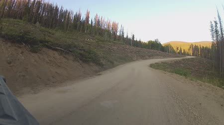 Hyperlapse car POV on a mountain dirt road in the summer