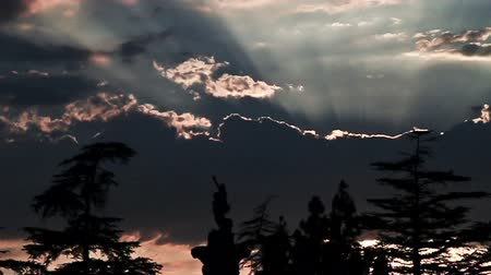 Dramatic sunset behind cemetery statues in time lapse Stock Footage