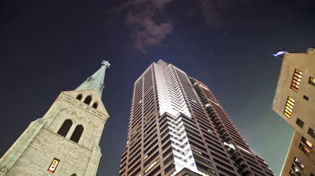 Low angle of Cathedral and Skyscraper in downtown Indianapolis, IN USA
