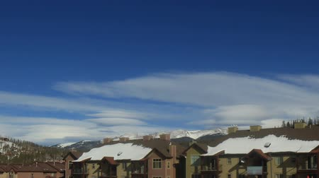 Time lapse clip of mountain ski town condos in winter