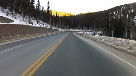 Driving POV hyperlapse through a mountain highway in the winter during the day