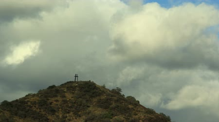 Religous Christian symbol on top of hill representing Father, Sun and Holy Ghost