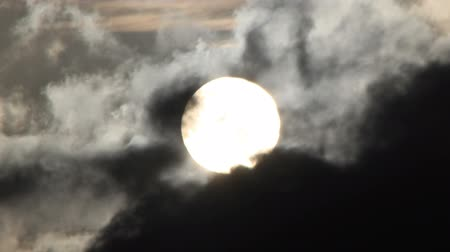 Close up view of the sun as clouds move by in timelapse