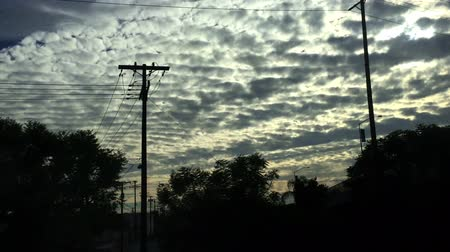 Crazy skies and moving silhouette through Los Angeles from train, Stock Footage