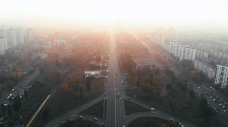 non kentsel : Aerial view of road junction in big city at sunset. Aerial highway junction, Colorcorrected 4k footage Stok Video