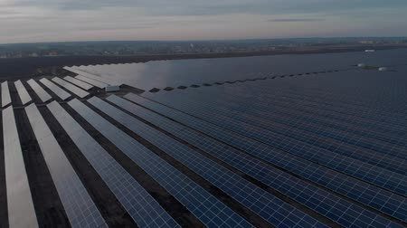photovoltaic : Aerial drone view into large solar panels at a solar farm. Solar cell power plants. footage video 4k.