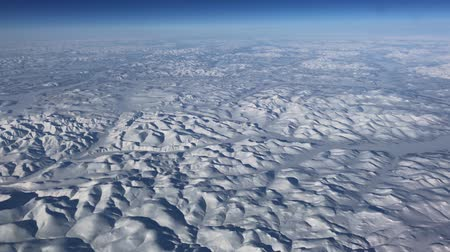 Aerial view of a winter wonderland over Manitoba,  Canada seen from an airplane window