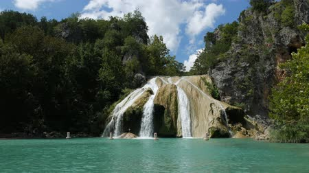 Beautiful steady shot of Turner Falls with a pool below, on a bright sunny day