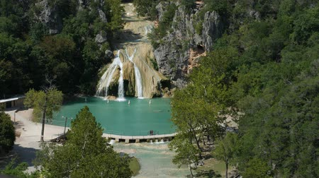 steady shot : Steady wide shot of Turner Falls with the natural swimming pool below it Stock Footage