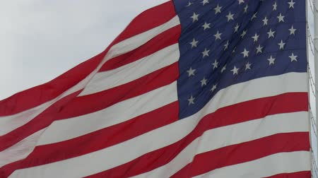 Steady close up shot of United States flag waving in the wind Wideo