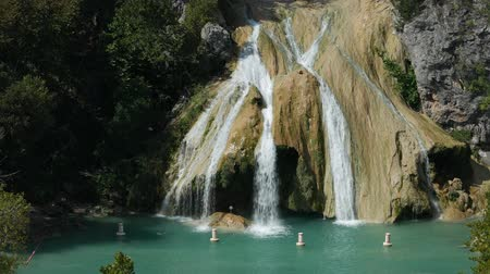 Medium wide shot of Turner Falls with the natural swimming pool below it