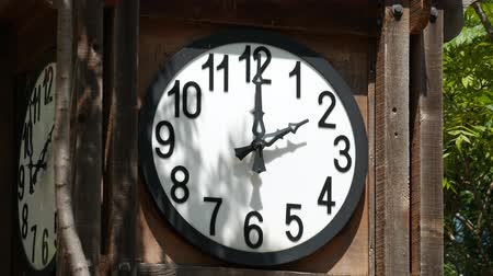 часов : Steady shot of white round clock mounted in a wooden crate, without a second hand