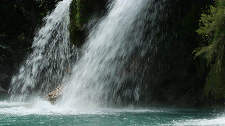 waterfall cascading into pool : Close up steady shot of waterfalls cascading down into a pool Stock Footage
