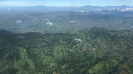Handheld aerial view of mountains and valleys in the southern Philippines