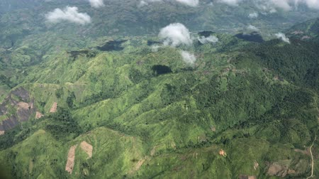 Handheld aerial shot of mountains and valleys in the southern Philippines