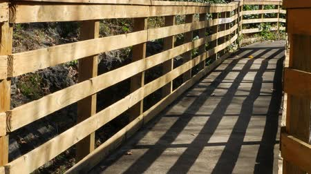 Wooden ramp and railings with shadows