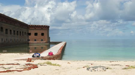 Wide shot of the walls of Fort Jefferson with the moat at the Dry Tortugas National Park.