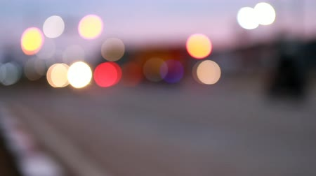 Night city lights with blur and bokeh effect, business center of the capital, traffic of cars