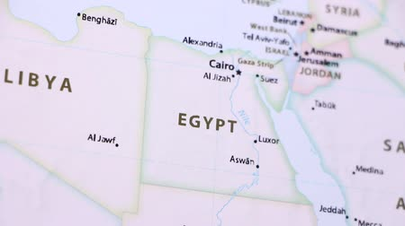 aswan : Egypt on the political map of the world. Video defocuses showing and hiding the map.