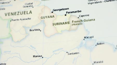 manaus : Guyana, Suriname, and French Guiana on the political map of the world. Video defocuses showing and hiding the map. Stock Footage
