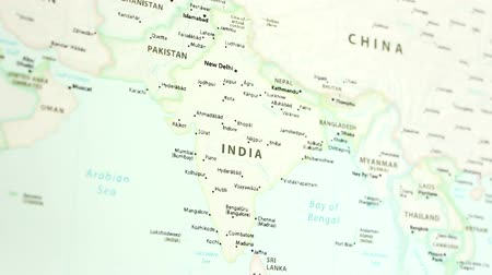 bombay : India on the political map of the world. Video defocuses showing and hiding the map.