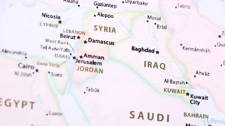 defocus : Iraq on the political map of the world. Video defocuses showing and hiding the map.