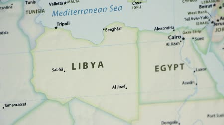 váll : Libya on the political map of the world. Video defocuses showing and hiding the map.