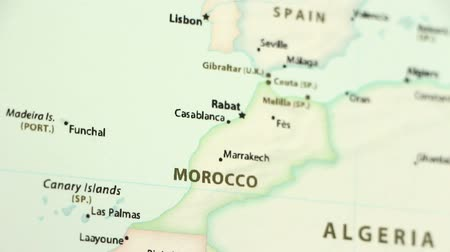 térképészet : Morocco on the political map of the world. Video defocuses showing and hiding the map. Stock mozgókép