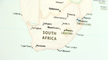 disagreement : South Africa on the political map of the world. Video defocuses showing and hiding the map.