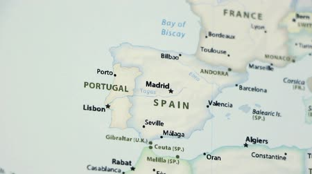 malaga : Spain and Portugal on the political map of the world. Video defocuses showing and hiding the map.