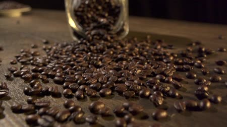 black coffee : Roasted coffee beans falling down.