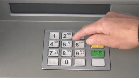 esterlino : A hand entering PIN code and taking cash from ATM Stock Footage
