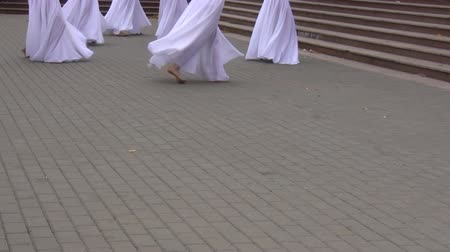 lower part : Clip showing lower part of bodies of girl dance group performing modern dance outdoor in the city Stock Footage