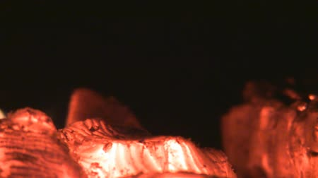 faszén : Zoom in red embers in the fireplace from nice  close up to abstract blur with a black copy space