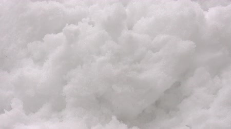avalanche : A bare human hand of buried by avalanche man shows up above snow surface Stock Footage