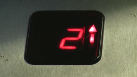 лифт : Inside moving up elevator. Close up of a digital display showing floor number and arrow in red.