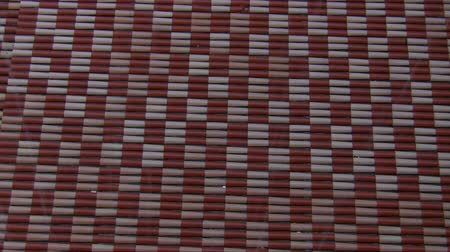 terracota : Red and white tile roof top pattern view through raindrops Stock Footage