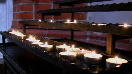catedral : View of rows of candles glowing in a church