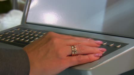 interactive table : Woman hand operating integrated trackball on industrial keyboard with part of display suitable for your text.