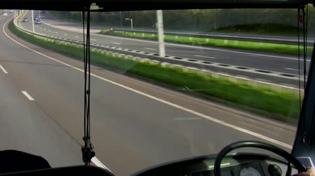 koç : View of the dashboard, motorway and transport from moving bus through the front window