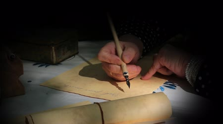 blank : Vintage scene with spotlight where a woman is writing a letter or document with a dip pen. Stock Footage