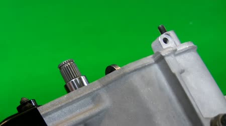 ferramenta : Partly assembled disassembled clean car gearbox is turned over. Isolated on green background.