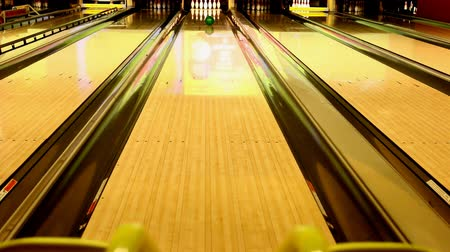 rolling pin : Ball rolling down the lane toward ten pins pushed from kids bowling ramp. Stock Footage