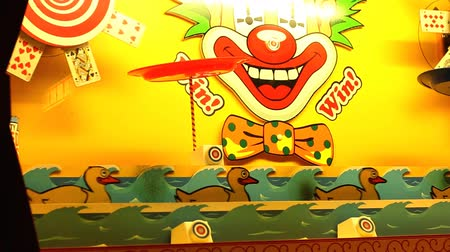 karnaval : Classic Victorian funfair stall in bright colors colours with moving row of shooting targets - wooden ducks.